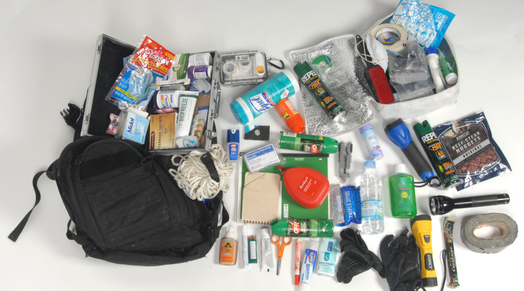 Emergency supplies next to a backpack