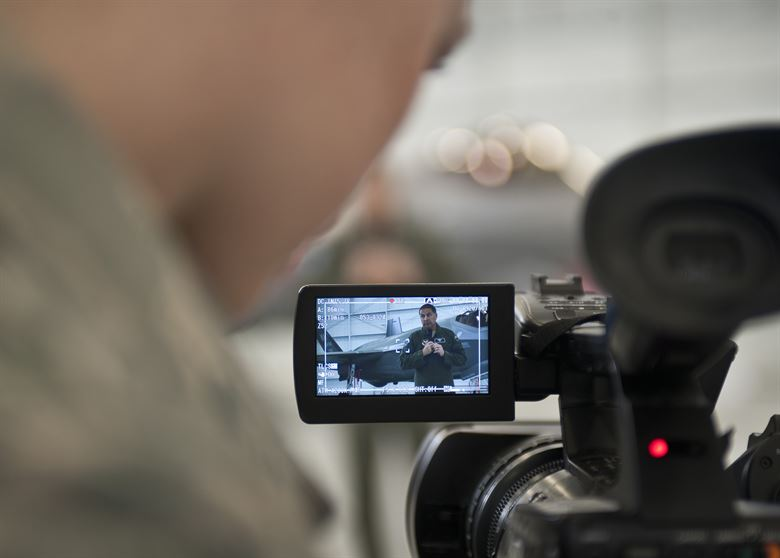 man making a video recording on his camera