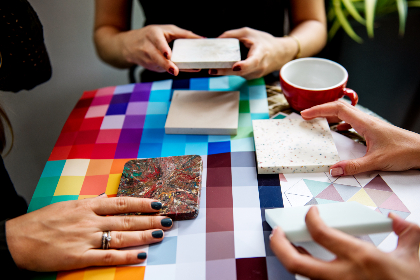 women handling color swatches and countertop samples