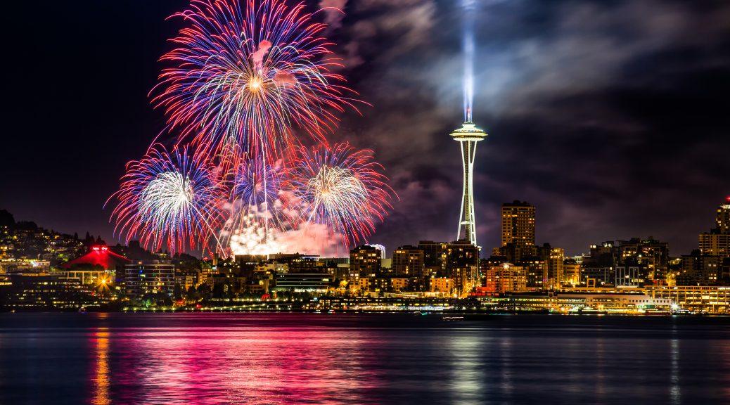 Fireworks over a dark Seattle skyline